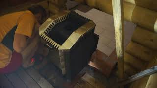 Установка и тест печи для бани Ермак 12 Премиум Чугун с выносной топкой и теплообменником  - монтаж